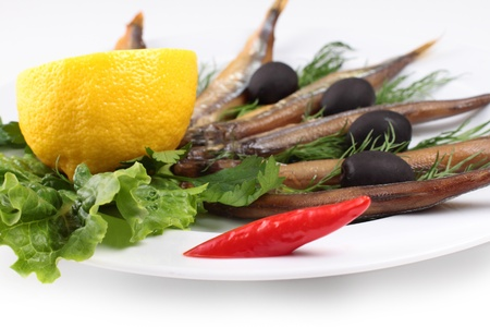 kipper: kipper fish on composition with vegetables close up