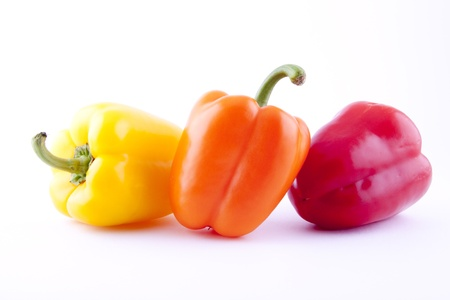 three bell peppers isolated on white background