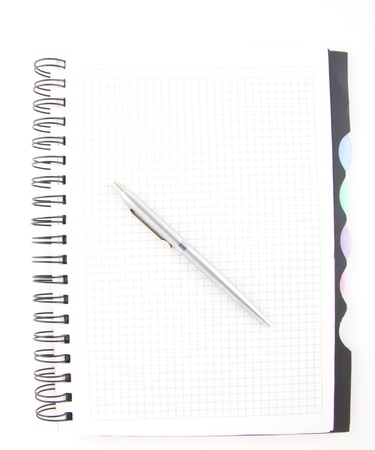 black pen and notebook isolated on white photo