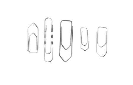 Collection of paper clips isolated on white photo