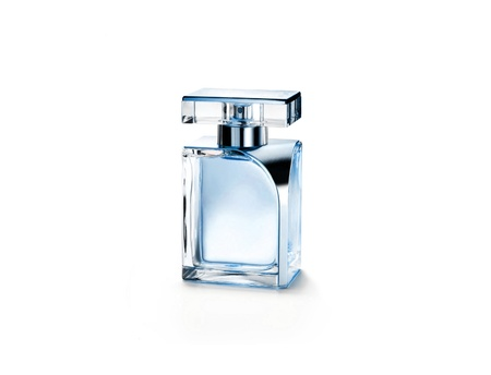 Perfume bottle on a glass surface photo