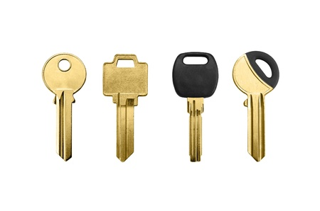 golden keys isolated on a white background photo