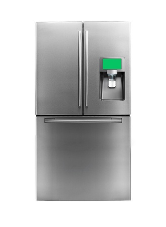 Modern refrigerator isolated on a white background photo