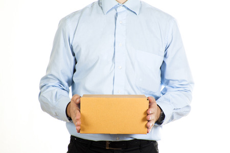 Businessman holding a paper box isolated photo