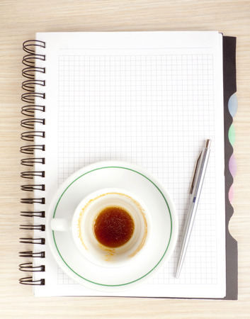 blank page, empty cup of coffe, pen photo