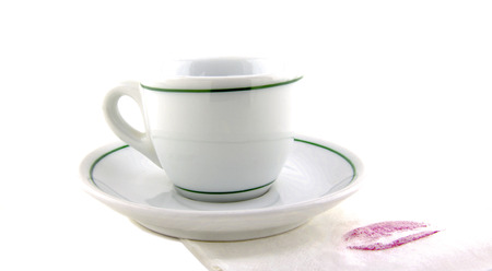 cup of tea and napkin with women kiss photo