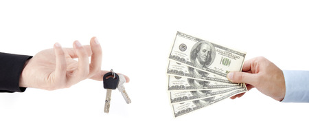 hands holdind money and car keys isolated on white background photo