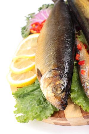isolaten: fish with lemon on plate isolaten on white Stock Photo