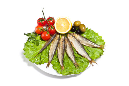 kipper: kipper fish on composition with vegetables isolated