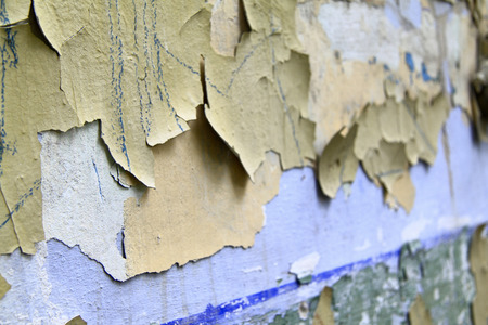crackles: Old paint peeling from wall background or texture Stock Photo