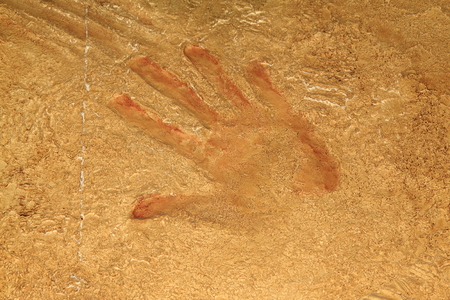 red hand: Red hand print on stone background or site