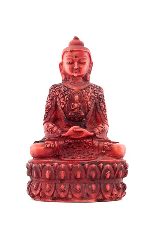 Red statue of budha front isolated on white photo