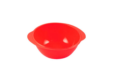 Red plastic bowl on a white background photo