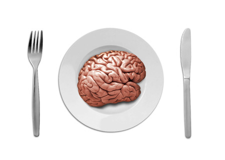 a human brain on plate with fork and knife photo
