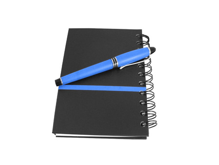 Notebook and pen isolated on white background photo