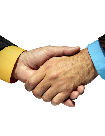 Labcoat arm shaking hands with Business suited arm