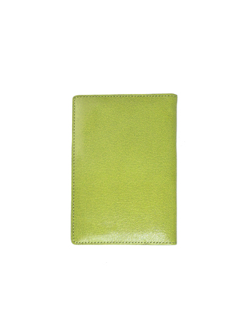 green leather case note book isolated on white background photo