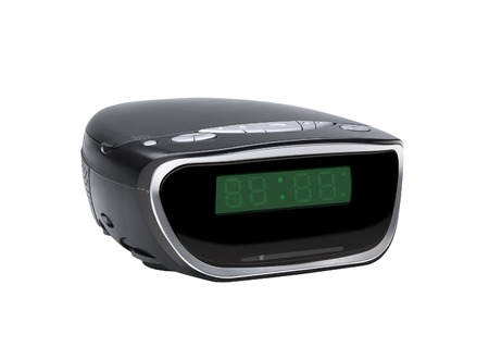 Digital alarm clock radio isolated over white background photo