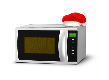 defrost: Christmas microwave over white Stock Photo