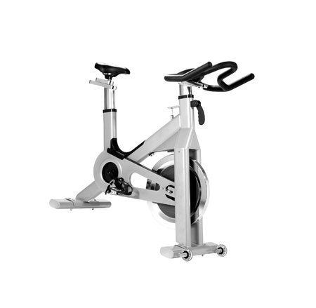 stationary bike: Stationary bike at the gym isolated on white