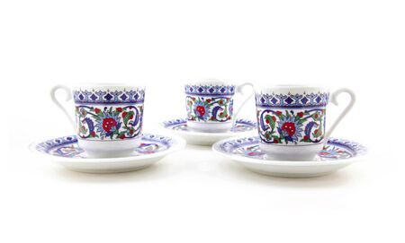 teacups: Ornamented teacups isolated on white Stock Photo