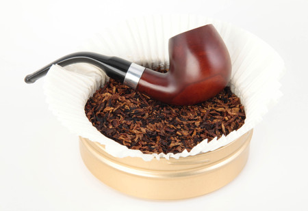 Wooden smoking pipe and tobacco
