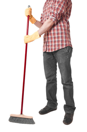sweeper: young worker with a broom
