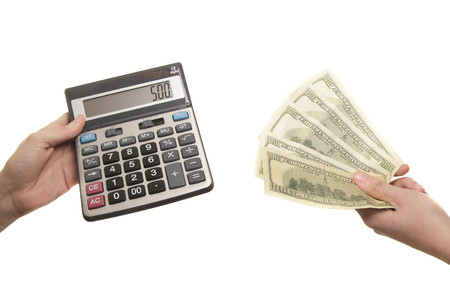 subtract: calculator and 500 dollars in hands Stock Photo