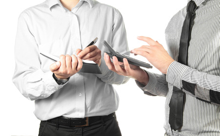 Two businessmen making calculations Stock Photo
