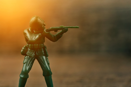 plastic soldier: Soldier holding a gun aimed at the enemy