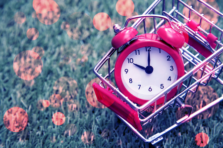 Red clock on the shopping cart, lack of time, waste of time, purchasing time, Shopping concept, Business concept.