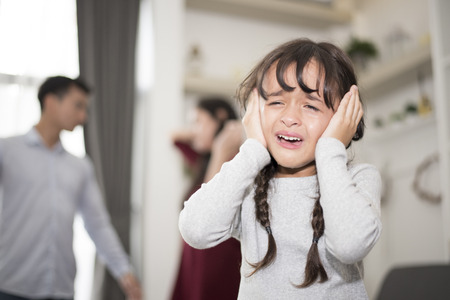 The girl was crying because dad and mom quarrel, Sad and dramatic scene, Family issued, Childrens Rights in Early Childhood Education and Social and parrents care problem concept Stock Photo