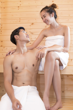 Asian lovers looking each other in sauna room, Heat treatment with steam, Holiday and Relax concept