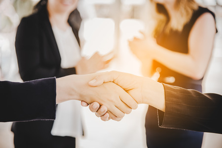Business people shaking hands after finish reach agreement for startup new project. Negotiating and Happy working concept. Handshake gesturing connection deal concept. People and teamwork theme