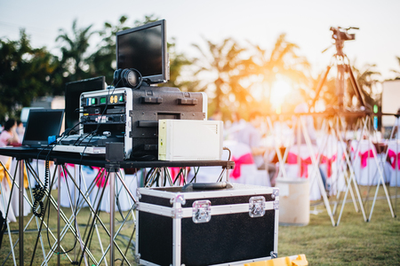 Dj mixing equalizer at outdoor in music party festival with party dinner table. Entertainment and Event organizer concept. Concert and Musical theme