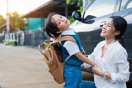 Mom send naughty boy before going to school in morning. Happy family and Lifestyles concept. Education and Back to school theme. Stockfoto