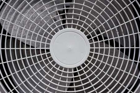 Close up of white air conditioner grille. Electronics industry and Material concept. Background and texture theme.