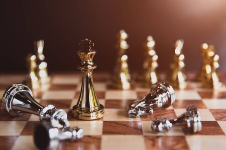 Chess board games for the last stand winner in business market sharing competition as professional and strong business investor. Leadership and successful strategy tactical concept background. Imagens