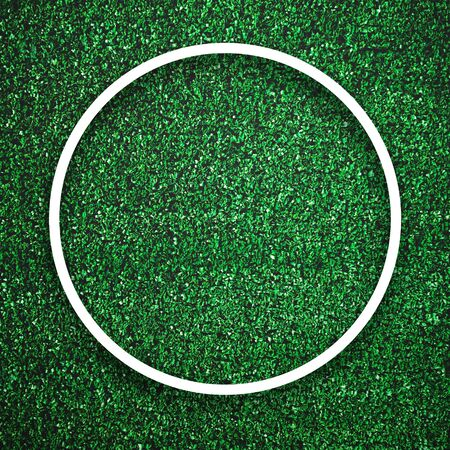 Circular white frame edge on green grass with shadow background. Decoration background element concept. Copy space for text insert in filled in black space.