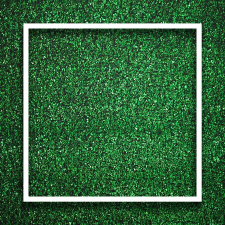 Rectangle square white frame edge on green grass with shadow background. Decoration background element concept. Copy space for text insert in filled in black space.