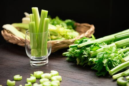 Bunch of fresh celery stalk on wooden table with leaves prepared for making juice. Food and ingredients  of healthy vegetable. Freshness herbal and low calories for dieting with plenty of vitamin