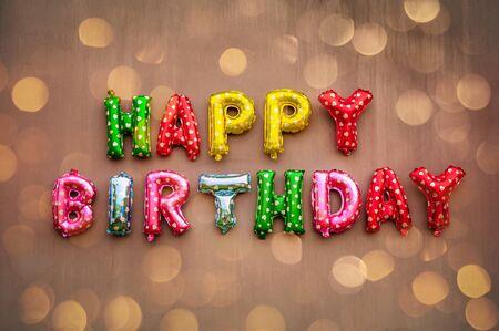 Happy Birthday alphabet text on wall background.
