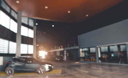 Blurred background of car showroom garage. Automotive car and business transportation concept. Abstract background.