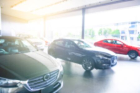 Blurred background of cars for sale in showroom. Automotive car and business transportation concept. Abstract background. Banco de Imagens