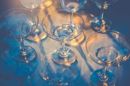 Row of wineglasses on table in nightclub bar and pub restaurant. Glassware and drinking beverage concept