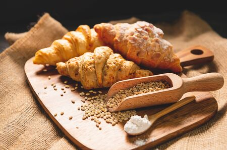 Different kinds of bread with nutrition whole grains on wooden background. Food and bakery in kitchen concept. Delicious breakfast gouemet and meal. Carbohydrate organic food cuisine homemade
