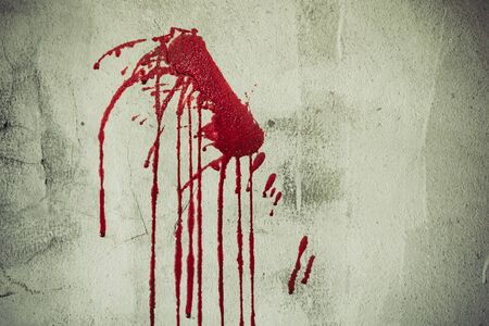 Splatter of red blood on wall in abandoned house. Halloween festival and event. Murder and Killer theme. Background for horror and scream film presentation. Criminal and social issues concept
