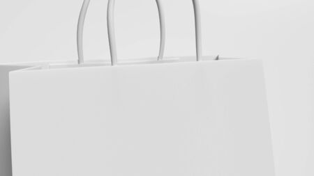 Closeup white shopping bag with handle rope on isolated white background. Object and Business accessories concept. 3D illustration rendering