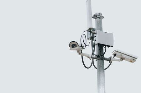 CCTV camera electric pole on isolated white sky with copy space. Safe and secure technology outside property and homeowner concept. Security card device and gadget theme. Outdoor electronic