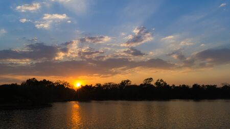 sihlouette: The sunset view from the river in Thailand . Stock Photo